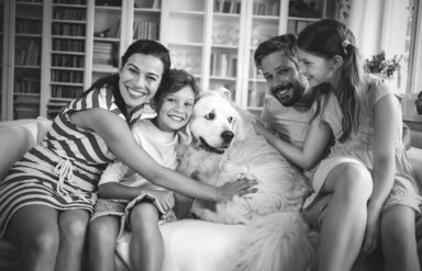 family hugging the dog