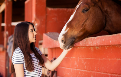 Woman during her equine therapy